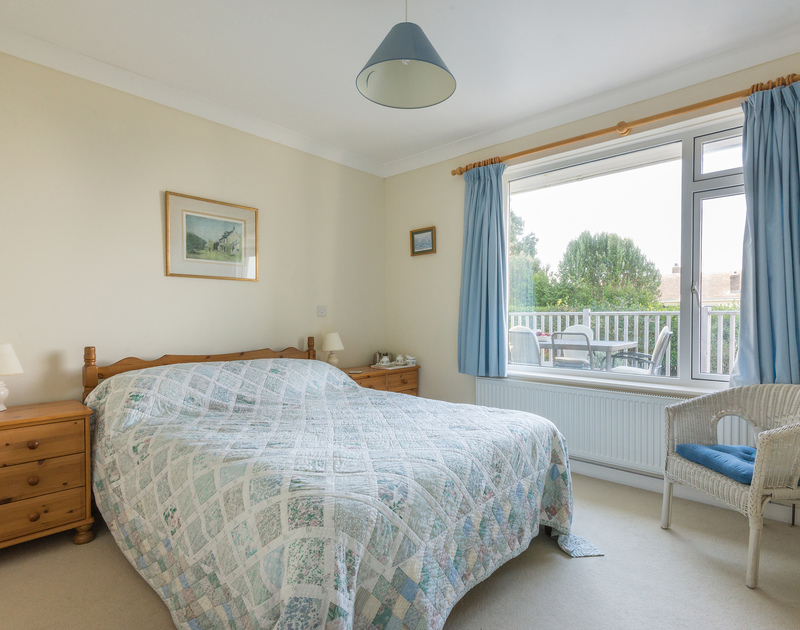 The double bedroom with ensuite shower room and views out to sea at The Glowdgie, a traditional self catering holiday home in New Polzeath, near Polzeath Cornwall.
