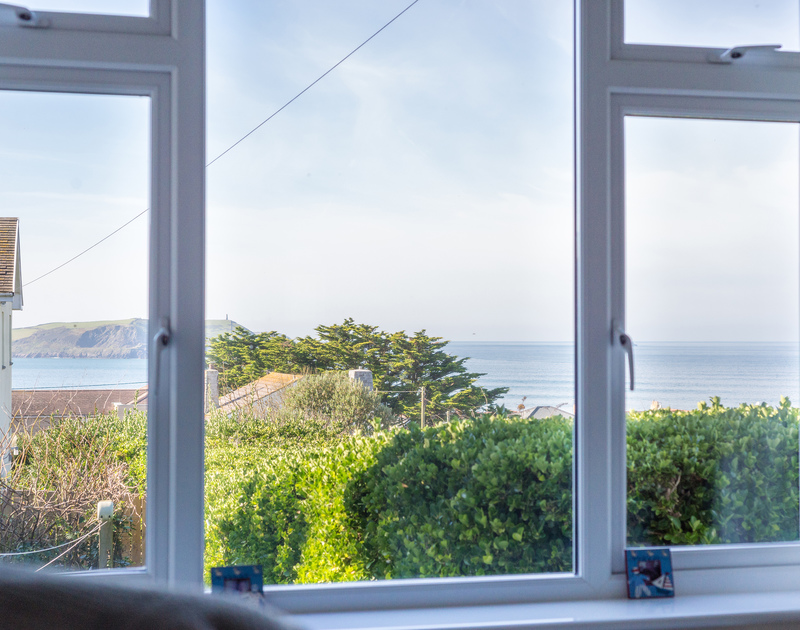 Enjoy a morning coffee with a sea view out to The Rumps from the master bedroom in The Glowdgie, a traditional self catering holiday home in New Polzeath, near Polzeath Cornwall.