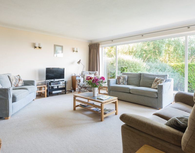 The comfortable living room with plenty of seating in The Glowdgie, a traditional self catering holiday home in New Polzeath, near Polzeath Cornwall.
