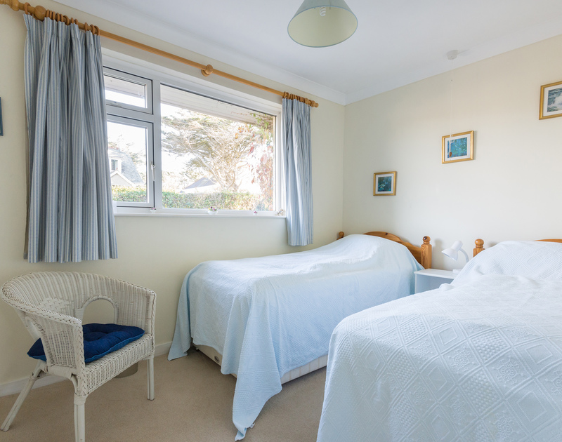 Twin bedroom in The Glowdgie, a traditional self catering holiday home in New Polzeath, near Polzeath Cornwall.