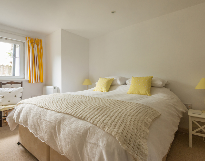 The ground floor bedroom at Sea Gulls in Rock on the Camel Estuary has an ensuite shower room and can be made up as a double or twin beds