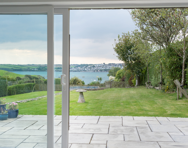 Slide open the living room doors to make the most of the sea views towards Padstow at Sea Gulls in Rock on the Camel Estuary