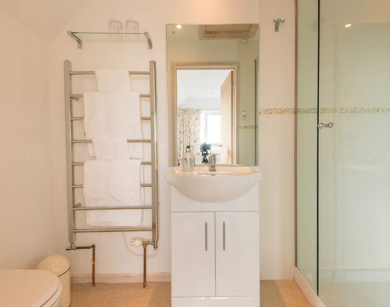 The stylish master ensuite at Sea Gulls in Rock, has a walk in shower enclosure