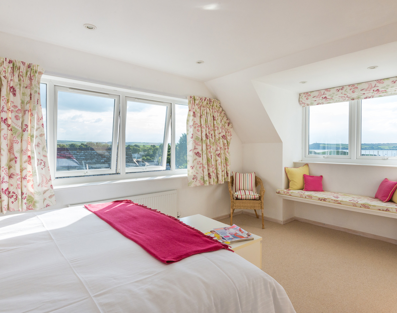 Dual aspect windows in the master bedroom suite at Sea Gulls in Rock make the most of the wonderful estuary and sea views