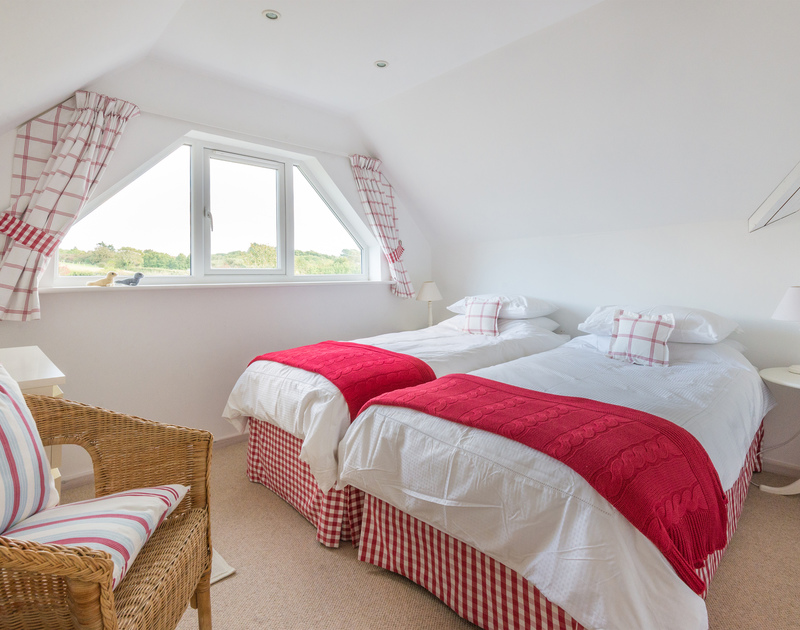 The cheery second twin bedroom located on the first floor at Sea Gulls in Porthilly, Rock on the Camel Estuary.