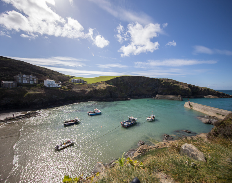 Beautiful Port Isaac's beach and harbour; a two minute walk away from The Fo'c'sle, a pretty old fishermans cottage for self catering holidays in North Cornwall.