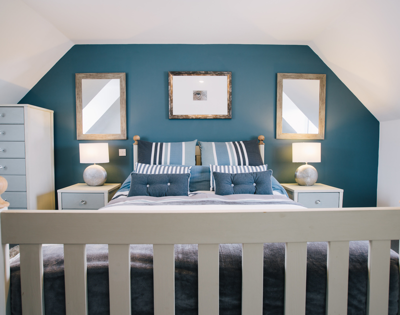 Relax in elegant style in the master bedroom suite on the first floor at Myth Cottage in Rock