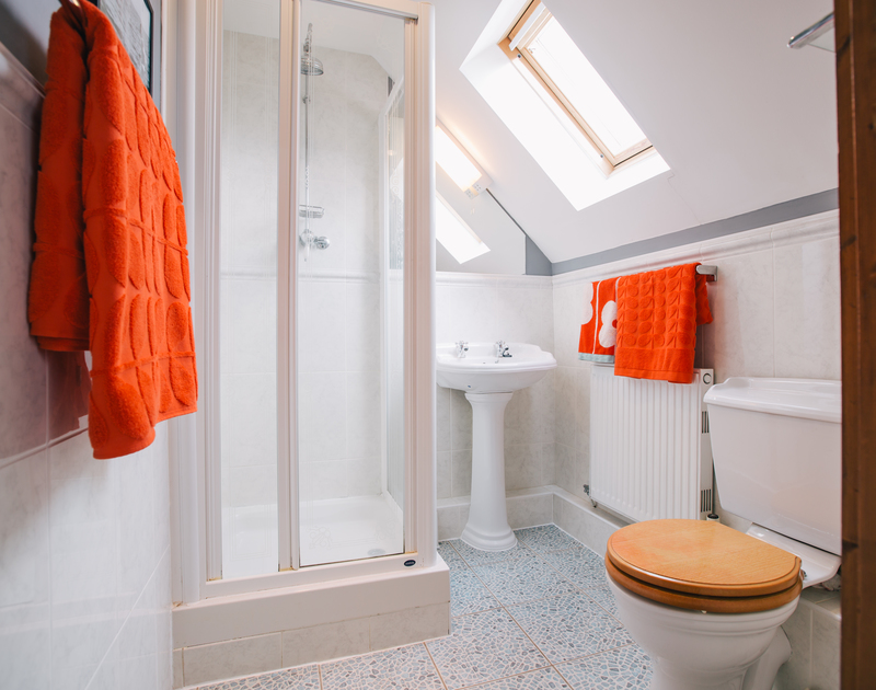The sunny master ensuite shower room at Myth Cottage, a self-catering holiday cottage in Rock
