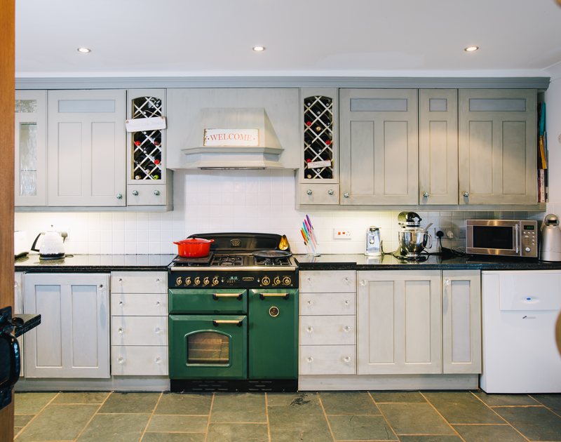 Enjoy creating wonderful family meals in the spacious fully fitted kitchen at Myth Cottage in Rock, Cornwall