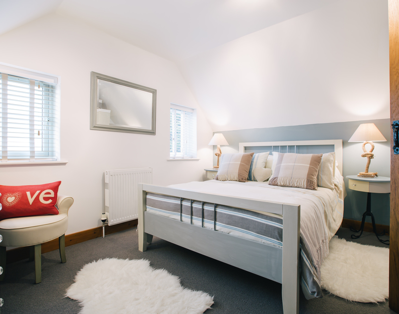 The second bedroom at Myth Cottage in Rock has a king size bed and shares the family bathroom