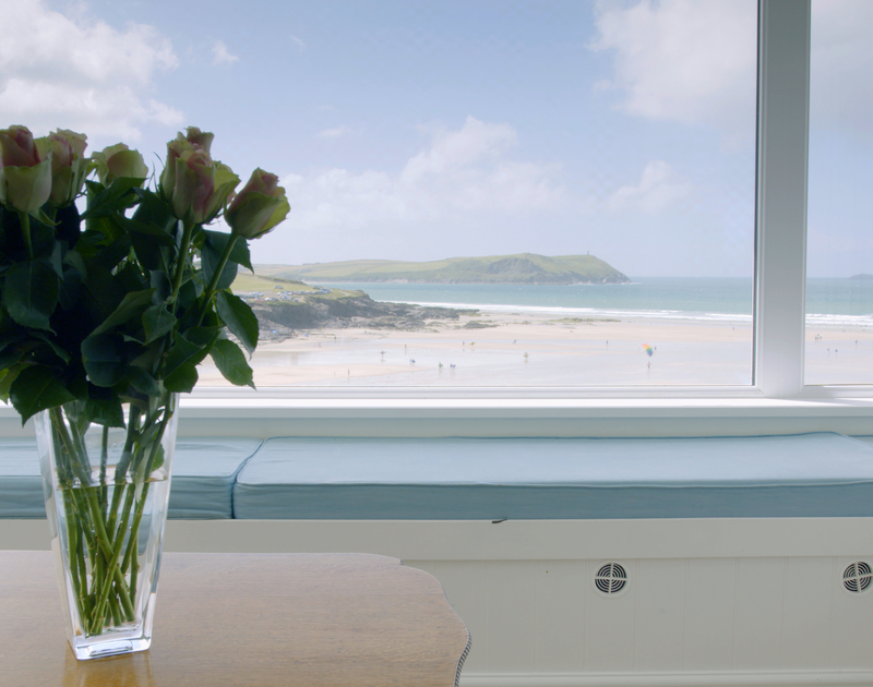 Relax in the living room at Treverden in Polzeath and soak up the stunning views of the beach and mouth of the Camel Estuary.
