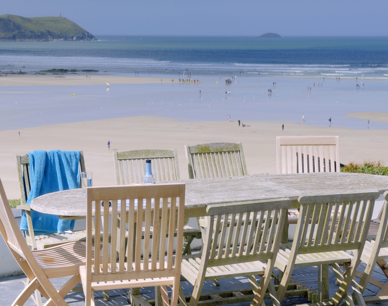 Enjoy long lunches, delicious dinners or afternoon drinks as the sunsets, on the expansive terrace at Treverden in Polzeath, Cornwall