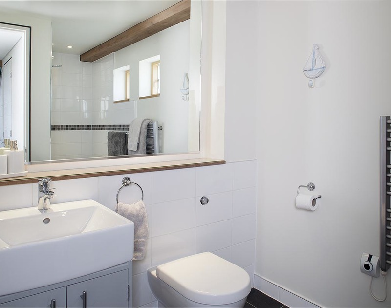The second ground floor bathroom sits alongside bedroom three and has a wet room shower