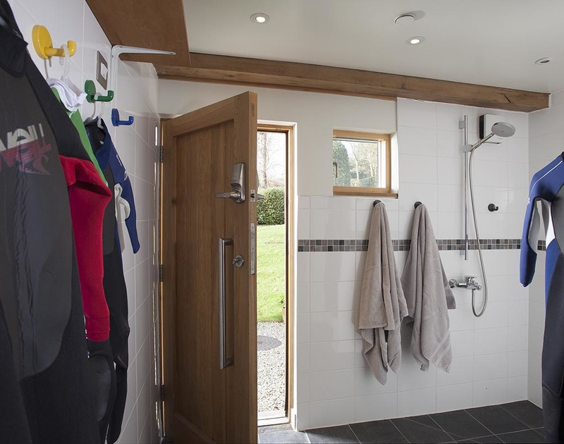 The spacious utility room at Gull Rock 4 has garden and garage access as well as a walk-in shower