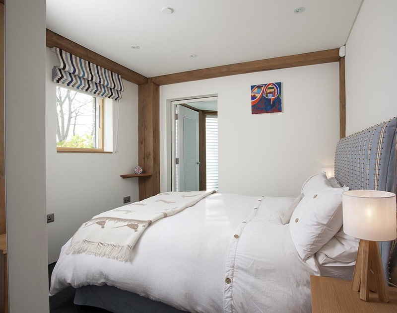 The ground floor double bedroom at Gull Rock 4 with adjacent TV/Play room and shared use of the family bathroom