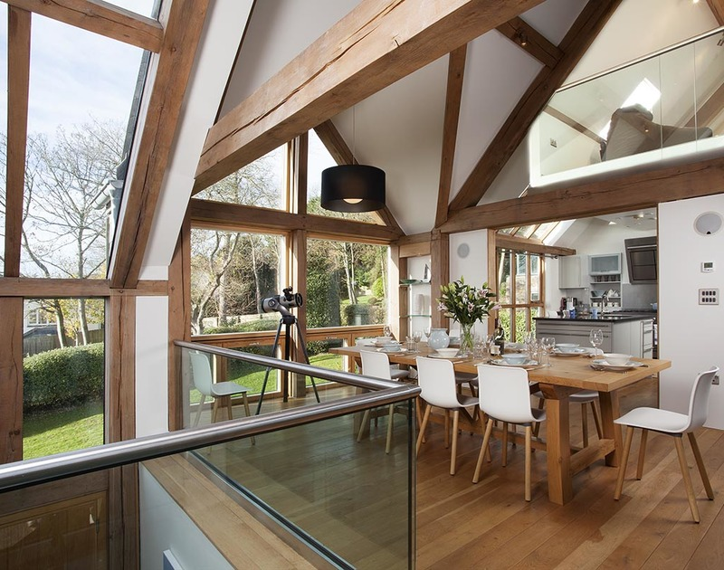 Large oak framed windows and glass balustrades allow light to flood into the large dining room at Gull Rock 4