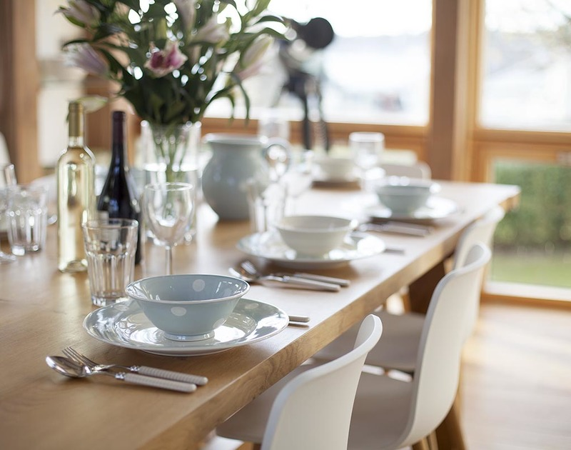 The beautiful solid oak dining table in the dining area at Gull Rock 4 lends itself to relaxed family meals