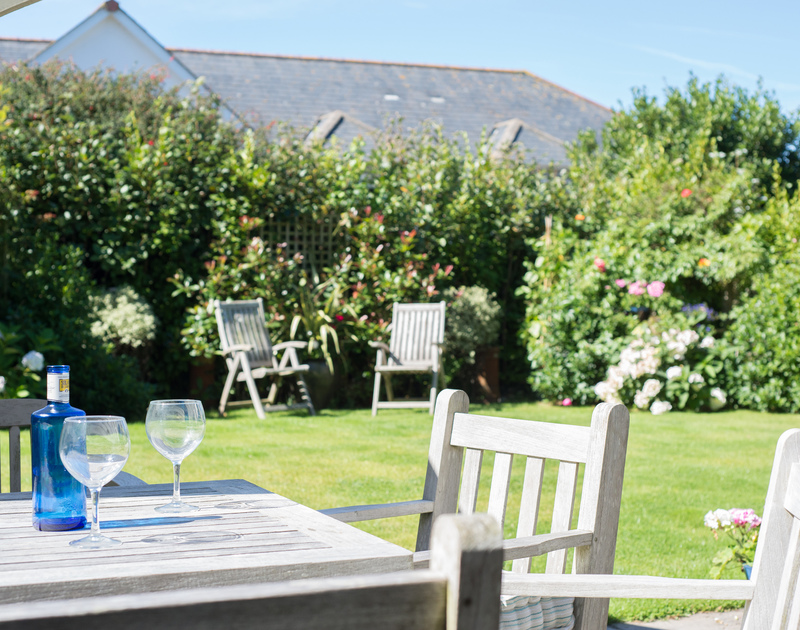 Enjoy family barbeques or just evening drinks in the sheltered garden at Borlase in Polzeath, Cornwall.