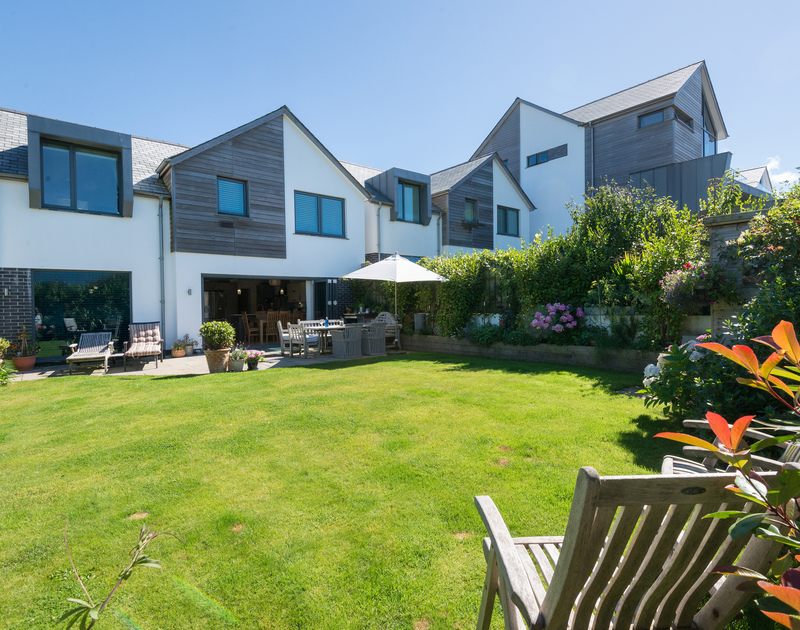 Enjoy Cornwall's mild climate from the south facing enclosed rear garden at Borlase, a luxury holiday home in Polzeath, Cornwall
