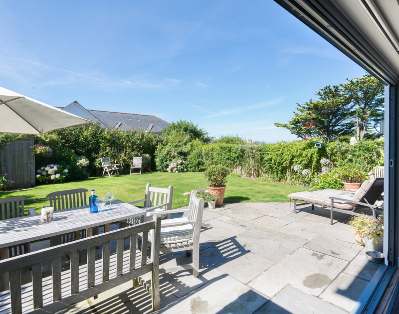 Open up the bi-fold patio doors on sunny days to make the most of Cornwall's mild weather at Borlase, a luxury holiday house in Polzeath