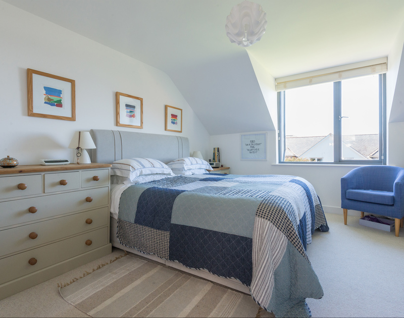 The spacious king size master bedroom suite at Borlase in New Polzeath, offers a calm retreat with an ensuite shower room.