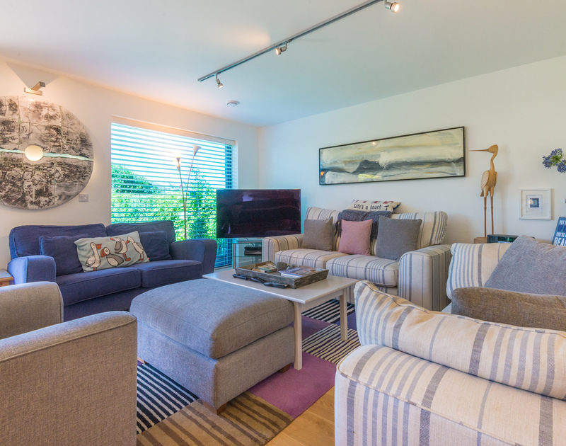 Relax in comfort and watch a favourite movie in the stylish and comfortable coastal inspired sitting room at Borlase, New Polzeath.