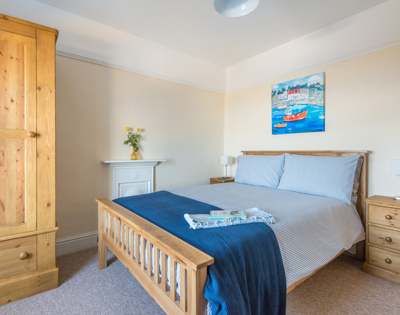 Sympathetically furnished and decorated master bedroom in The Porthole, a self catering holiday house in Port Isaac.