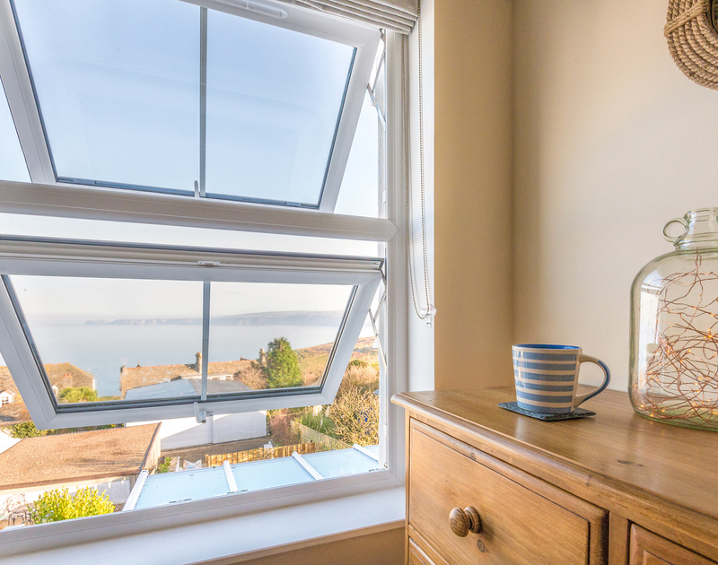 Beautiful sea and coastal views over the roofs of Port Isaac village from the single bedroom in The Porthole.