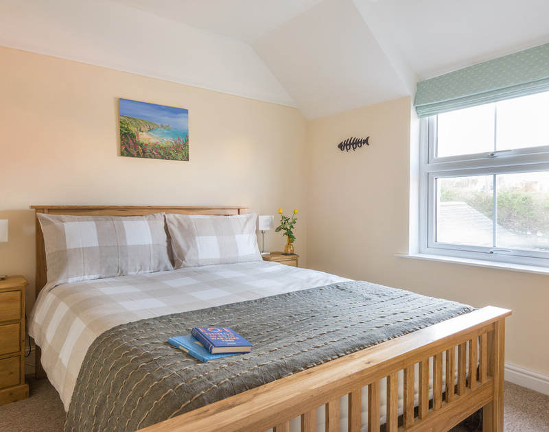 The double bedroom in self catering holiday cottage The Porthole in Port Isaac, Cornwall.