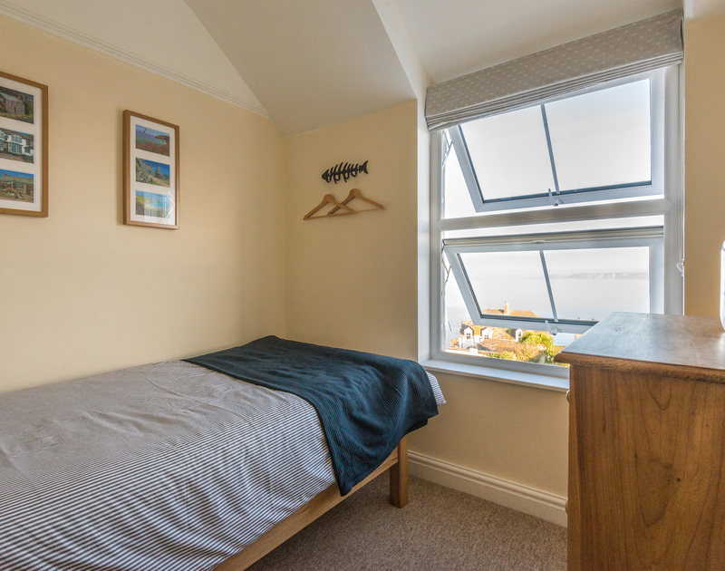 The single bedroom benefiting from sea and coastal views over the village at Port Isaac in North Cornwall.