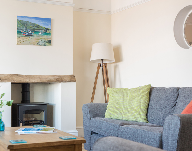 Take advantage of the modern, efficient woodburner to create warmth and atmosphere on cooler Cornish evenings in self catering holiday property Porthole in Port Isaac, Cornwall.