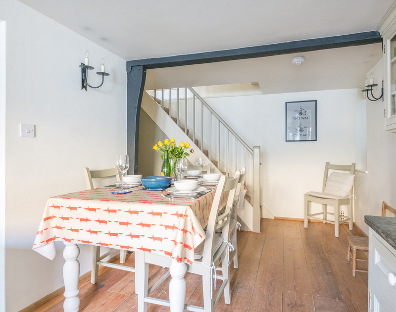 The pretty dining room in the characterful and beautifully presented Kicker Cottage, a self catering holiday retreat in Port Isaac.