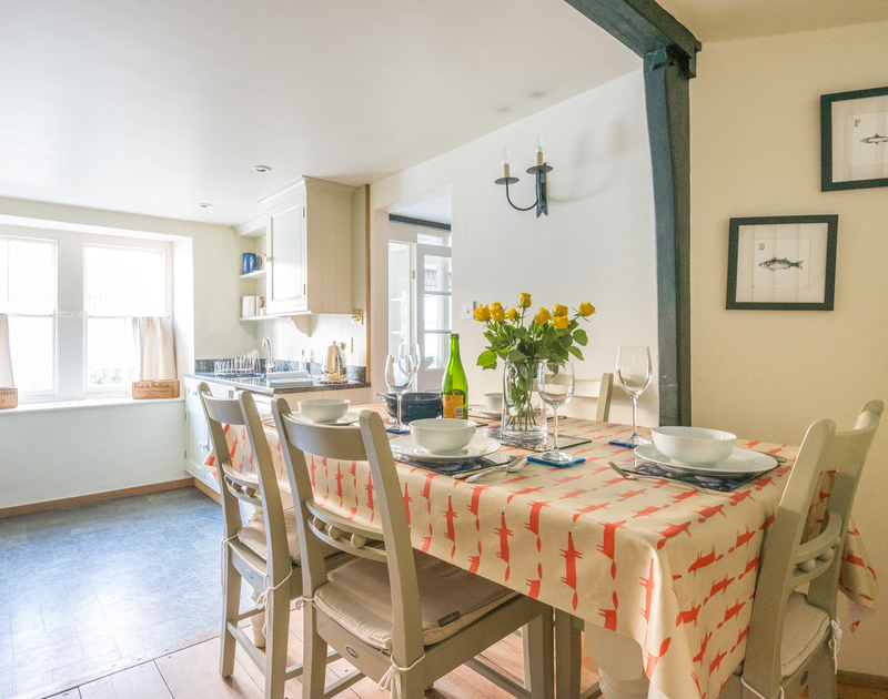 The open plan kitchen dining, room benefits from plenty of light flooding in from the windows in pretty Kicker Cottage in Port Isaac.
