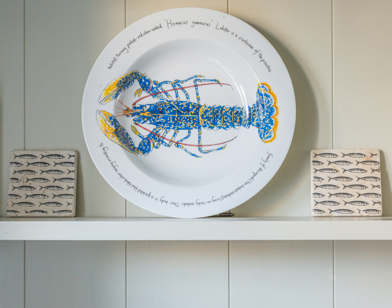 Kicker Cottage in Port Isaac has been thoughtfully furnished with these seaside themed details in the kitchen.