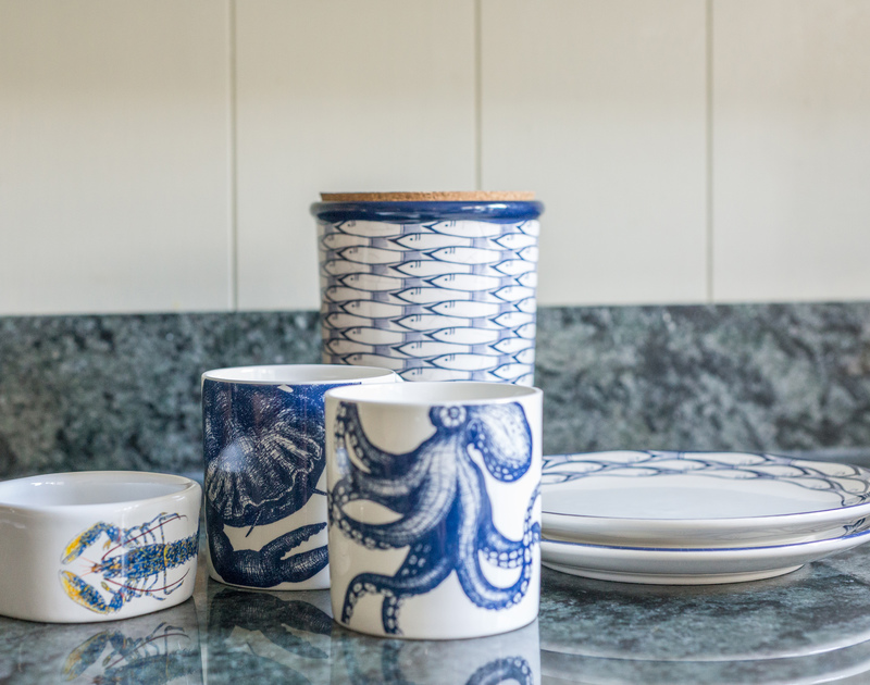 Sea creatures on the blue and white crocks in the kitchen at Kicker Cottage enhance the seaside feel throughout.