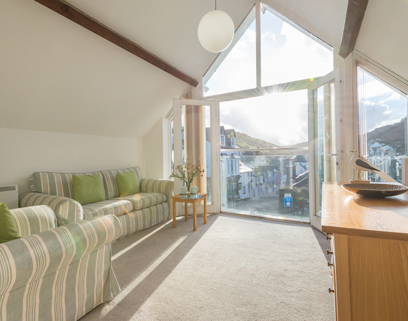 Enjoy lovely views of Port Isaac's old village and the harbour from Gully Lofts' sitting room and balcony