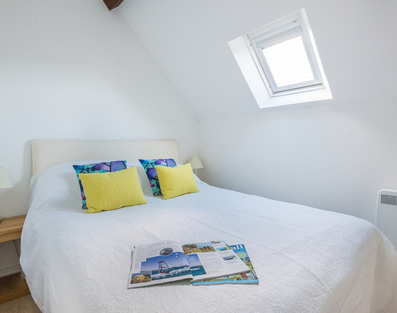 Snuggle up in the cosy double bedroom of Gully Lofts, a characterful holiday rental in Port Isaac