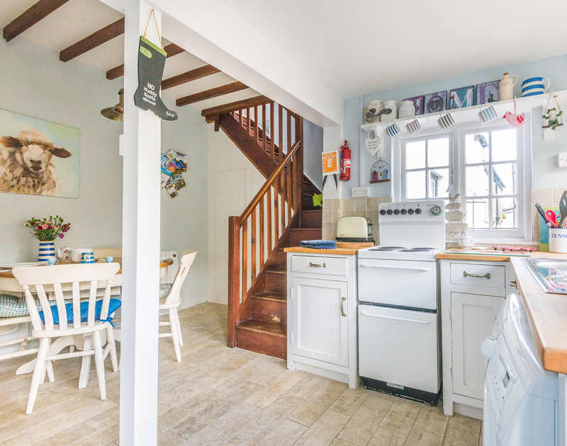 The sunny, characterful kitchen diner at Fo'c'sle, a self-catering holiday rental in Port Isaac