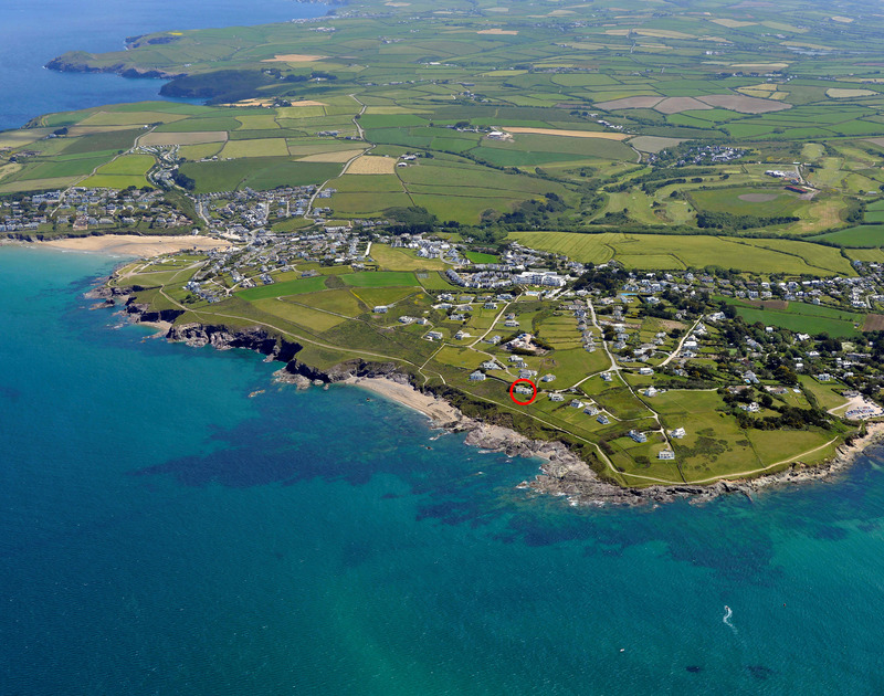 This is an aerial view of Thalassa a traditional stone built dogfreindly holiday cottage in an outstanding setting near Daymer Bay in Cornwall with uninterrupted sea views.