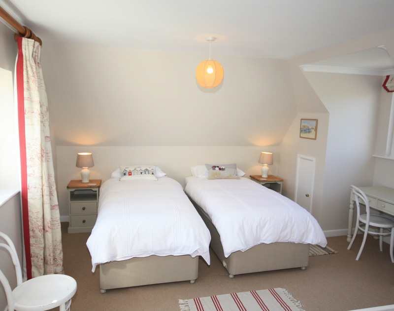 The upstairs twin bedroom at self catering holiday house Bay View Cottage in popular Daymer Bay in North Cornwall.