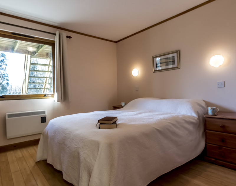 The second double bedroom at Owls Rest in Rock has a south facing window and shares the family bathroom