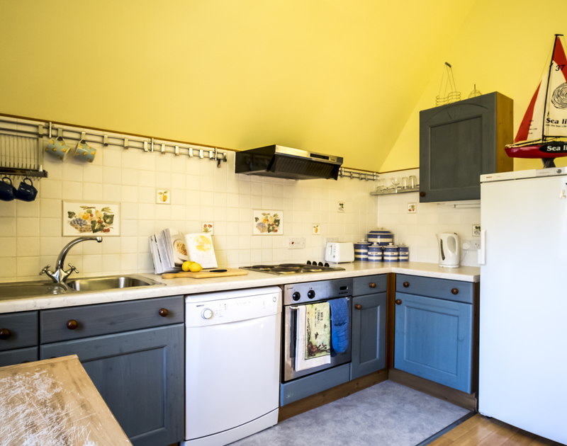 An open plan kitchen at Owls Rest in Rock, Cornwall allows you to stay close to family members even while preparing meals