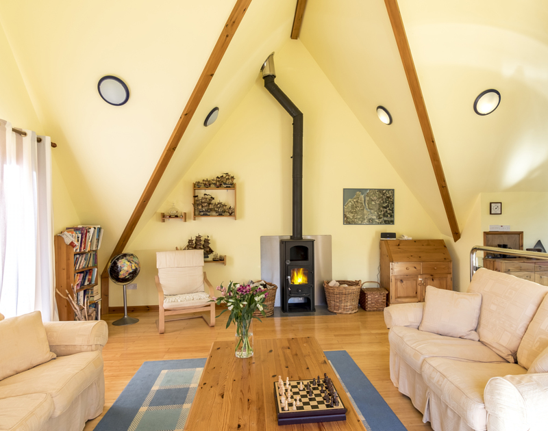 Light the log burner at Owls Rest in Rock, Cornwall and relax in this bright and sunny space with your family.