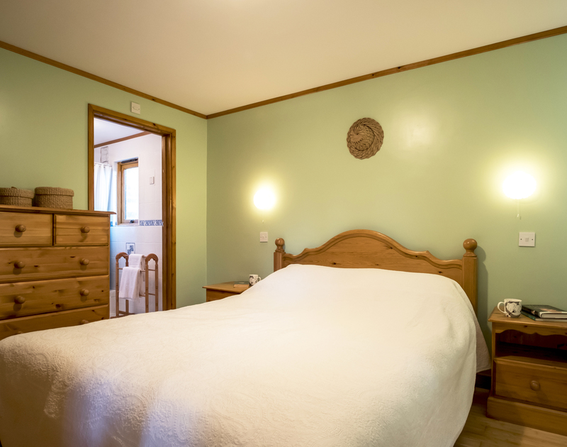 The master bedroom at Owls Rest in Rock, Cornwall has an ensuite shower room and is set on the ground floor.