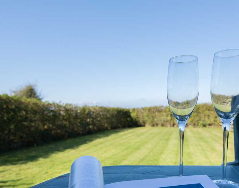 Enjoy a quiet drink in the peaceful garden at Puffin Cottage, a self catering holiday cottage in Rock, Cornwall.