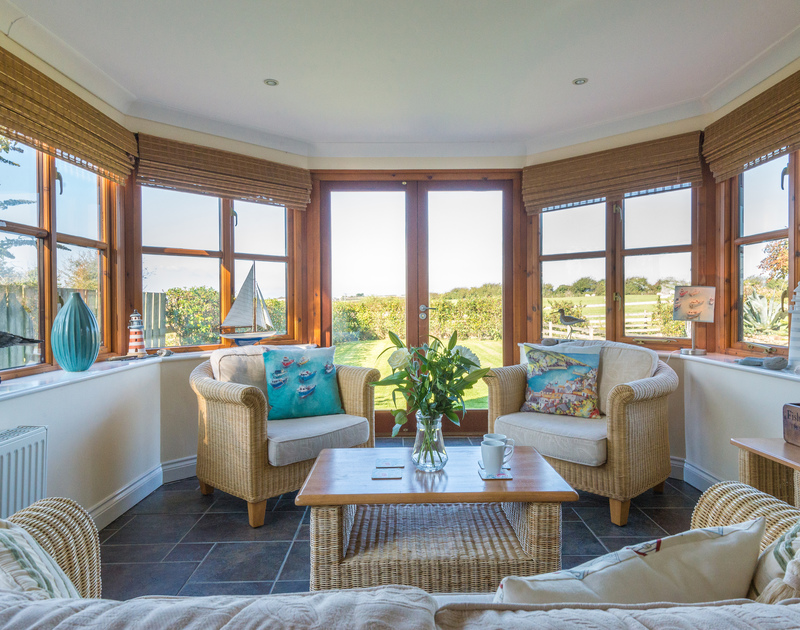 The sunny conservatory in Puffin Cottage, a self catering holiday house to rent in Rock, North Cornwall.