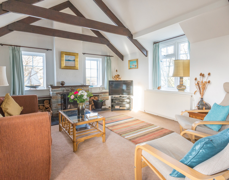 The sitting room on the first floor with exposed beams and a vaulted ceiling in Little Pityme,a self catering holiday house to rent in Rock, Cornwall.