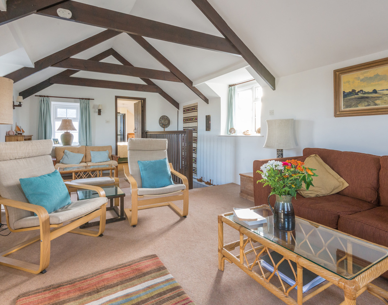 The cosy sitting room in Little Pityme, a traditional self catering holiday cottage in Rock, Cornwall.