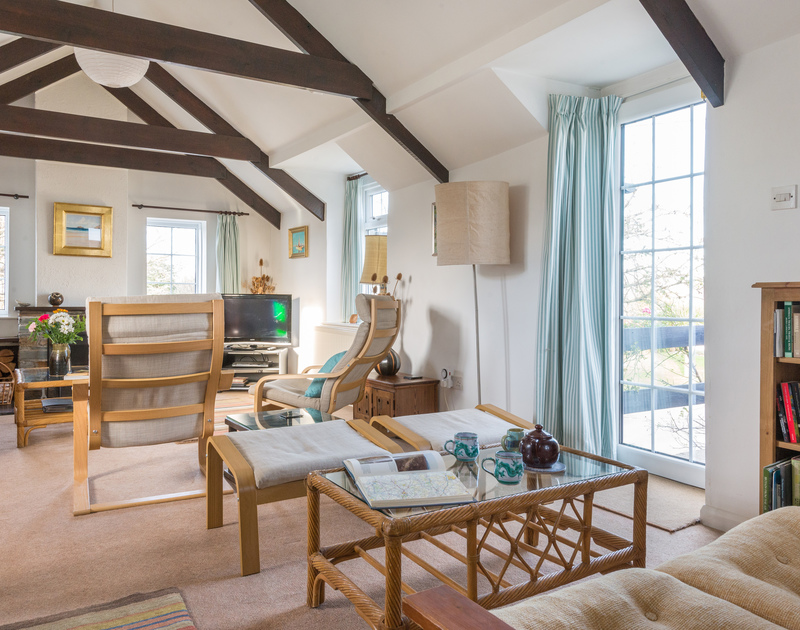Relax in the cosy living room in Little Pityme, a traditional self catering holiday cottage in Rock, Cornwall
