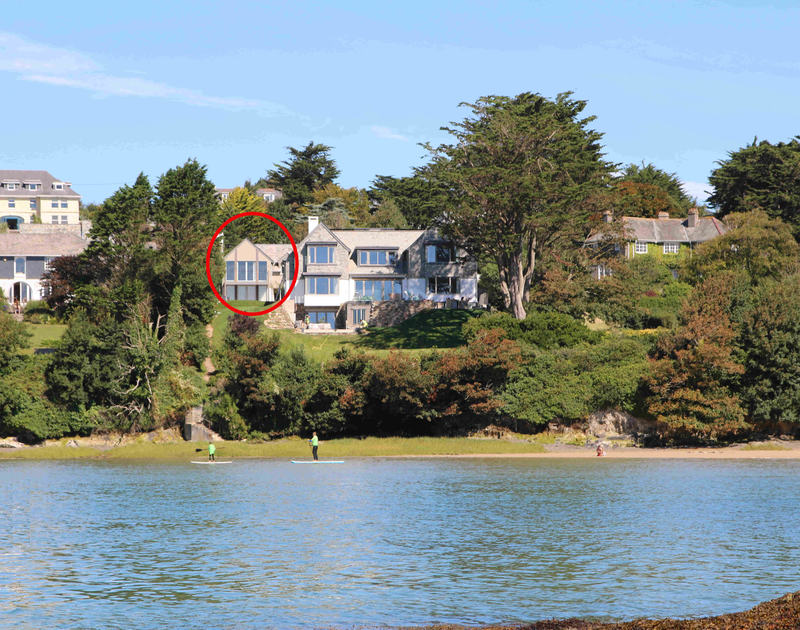 The view from the beach of Tregye, a luxury holiday house in Rock, Cornwall, with ample parking space and lawned garden.
